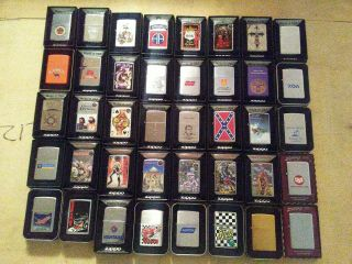 40 Vintage Camel Zippo lighters,  40 Other Zippos,  Display unfired 80 total 5