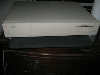 Amiga 1000; Includes Keyboard,  Mouse And Powercord.