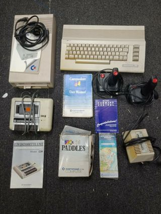 Commodore 64 Computer With Accessories.  Datasette,  Books,  Floppy Etc.