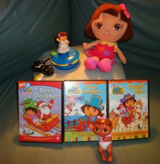 Fisher Price Nickelodeon Dora The Explorer Plug & Play,  2 Dora Dolls,  3 Dvd