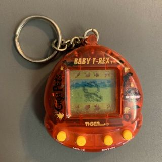Giga Pets Baby T - Rex Jurassic Park Tiger Electronic Keychain 1997 - Great