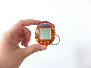 On Hold Tamagotchi Connection,  V1,  Orange Transparent Glitter,  Bandai 2004