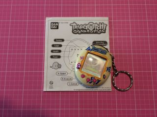Tamagotchi Connection V2 (yellow,  Butterfly Shell,  Instructions)
