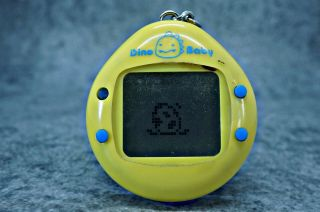 Dinosaur Dino Baby Yellow Tamagotchi 1997 Virtual Pet Game