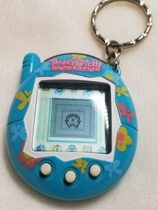 2004 Bandai Tamagotchi Connection Turquoise W/butterflies Battery.
