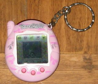 2004 Tamagotchi Connection Virtual Pet Version Bandai Pink Bow Ties Wear