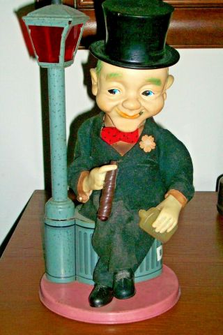 Vintage 1950s Battery Operated Tin Toy Top Hat Man Sitting On Dust Bin Lamp Post