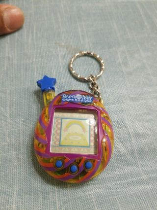 Tamagotchi Connection Virtual Pet Version V4.  5,  Version 4.  5 T - Yellow Swirl 2004