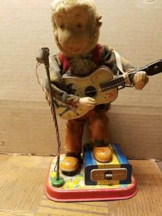 Vintage Made In Japan Battery Operated Signing Monkey Tin Toy